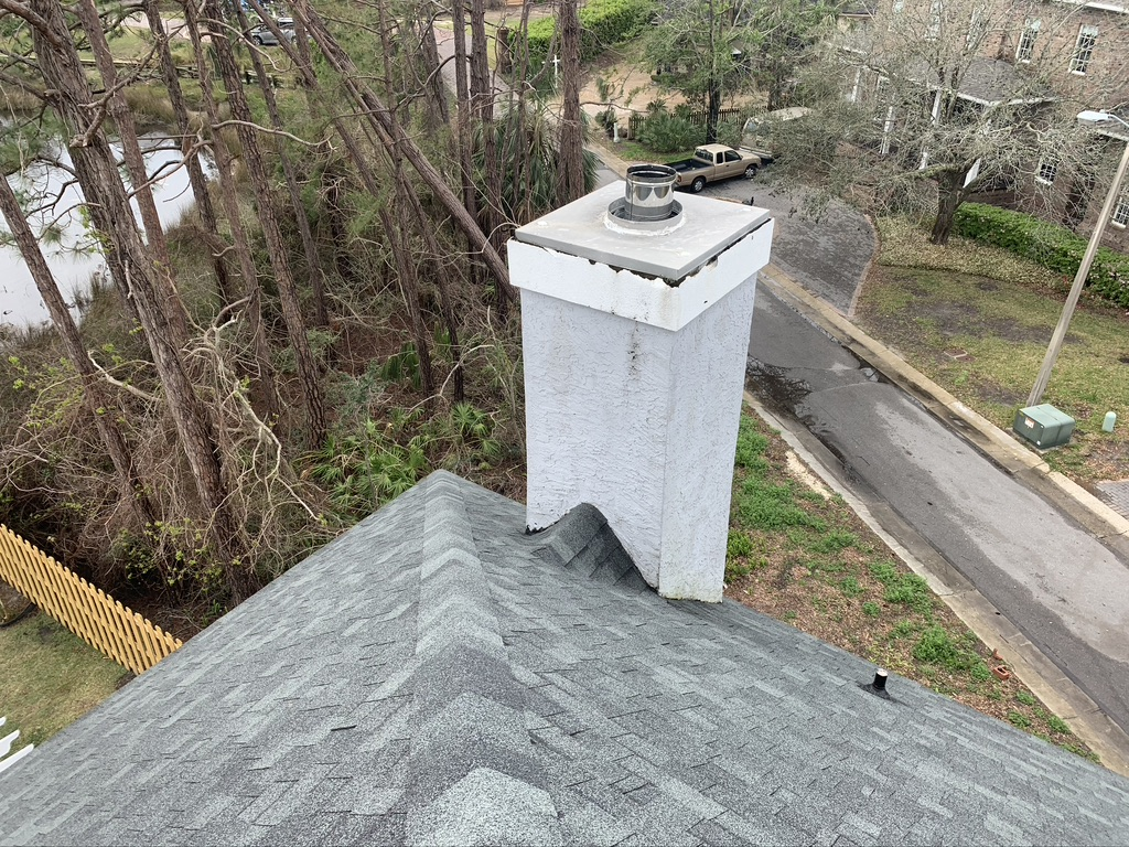 Allstar team repairing chimney on dangerous roof in Daphne