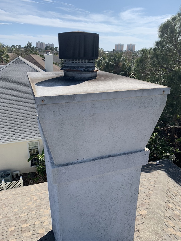 Allstar technicians inspecting a chimney cap in Foley.